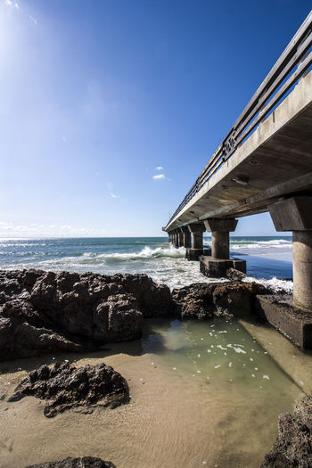 Oceans, rocks and concrete. Pier Architecture Beach Beauty In Nature Blue Bridge - Man Made Structure Built Structure Concrete Day Horizon Over Water Nature No People Outdoors Pillars Rockpool Rocks Rocks And Water Scenics Sea Sky Water