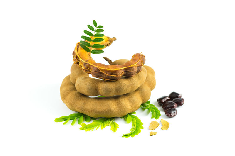 Fresh sweet tamarind isolated on white background with leaves, seeds and bark of tamarind, Can be used as a health drink, tamarind juice. ASIA Asian  Background Bean Beverage Brown Closeup Cold Delicious Dessert Drink Eating Edible  Exotic Food Fresh Freshness Fruit Green Group Health Healthy Horizontal Ingredient Isolated Juice Juicy Leaf Mint Nature Nutrition Nutritious Open Organic Raw Refreshing Ripe Seed Shell Sweet Tamarind Tamarindus Tasty Thai Thailand Tree Tropical Vegetable Vitamin White