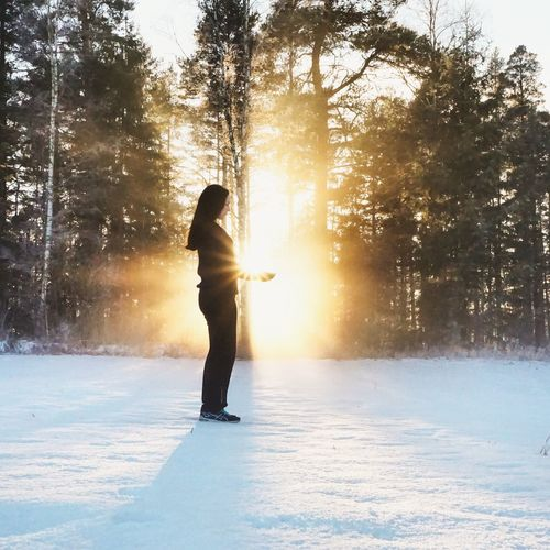 Holding the sun ☀ Winter Snow One Person Cold Temperature Sunlight Tree Outdoors Sunset Silhouette Full Length Winter Sport Nature Ice People Beauty In Nature One Woman Only Adult Adults Only Day Ice Rink