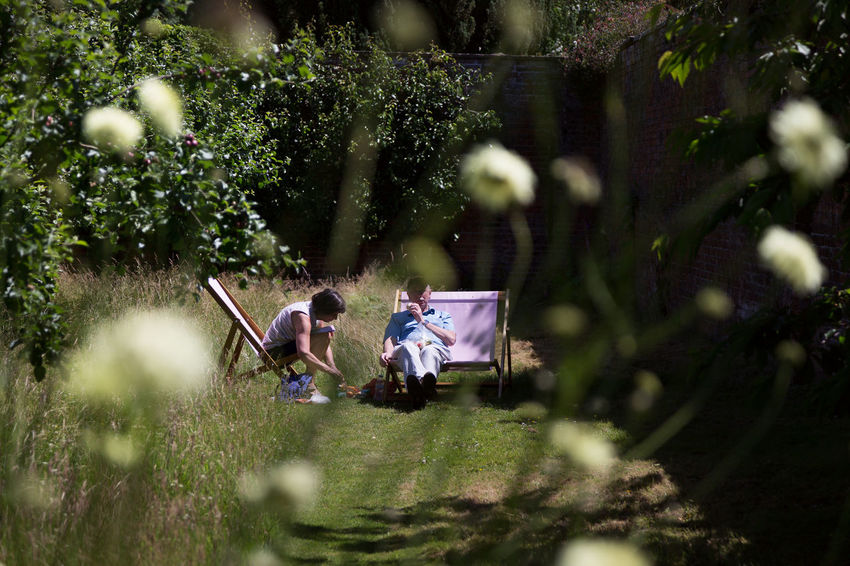 English Picnic - Adult Casual Clothing Day Flower Focus On Background Full Length Garden Grass Nature Outdoors People Plant Selective Focus Togetherness Tree Two People