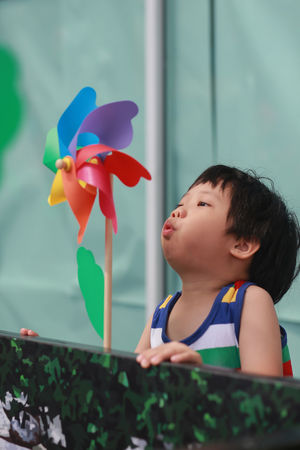 Kid playing with pinwheel outdoor Boys Casual Clothing Child Childhood Cute Day Flowering Plant Innocence Leisure Activity Lifestyles Looking Looking Away Males  Men Mouth Open Nature One Person Outdoors Pinwheel Toy Plant Real People