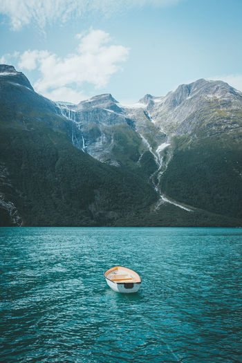 Mountain Water Nautical Vessel Sky Scenics - Nature Beauty In Nature Waterfront Tranquil Scene Day Tranquility Sea Nature Mountain Range No People Idyllic Outdoors Floating On Water Lake Lake View Travel Travel Destinations Landscape Nature Nature_collection Nature Photography