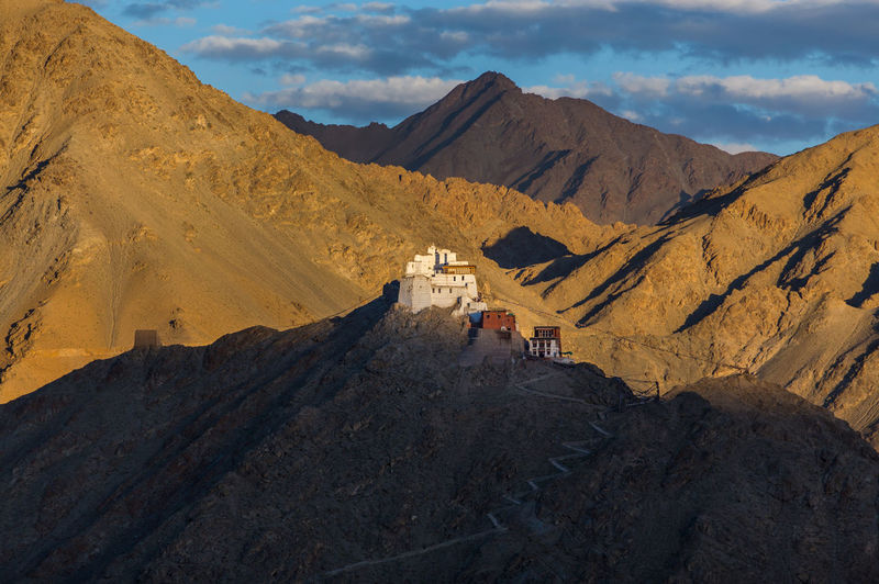 Leh Palace Arid Climate Beauty In Nature Climate Cloud - Sky Day Environment Formation Group Of People Landscape Leh Mountain Mountain Range Nature Non-urban Scene Outdoors Real People Rock Rock - Object Scenics - Nature Sky Solid Sunlight Tranquil Scene Tranquility