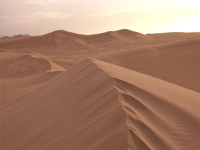 Arid Climate Atmospheric Beauty In Nature Brown Climate Day Desert Environment Extreme Terrain Land Landscape Nature No People Non-urban Scene Outdoors Remote Sand Sand Dune Scenics - Nature Sky Tranquil Scene Tranquility