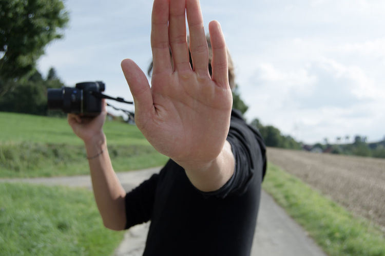 Stop Hands Camera - Photographic Equipment Cloud - Sky Day End Of Way Focus On Foreground Hand Human Hand Leisure Activity Men One Person Outdoors People Photographing Photography Themes Real People Sky Stop Technology My Best Photo