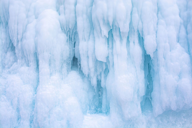 Blue ice stalactite on cliff, winter season in siberia, russia, nature background image