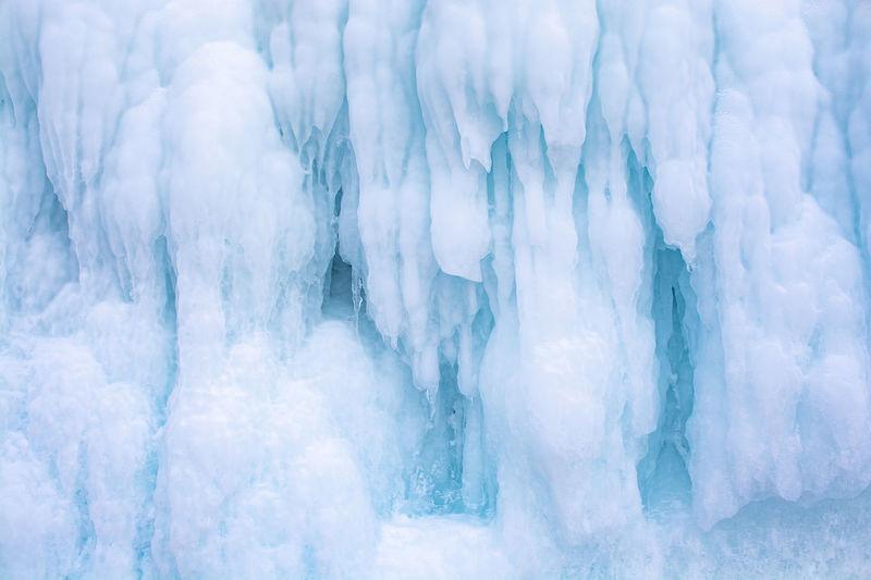 Blue ice stalactite on cliff, winter season in siberia, russia, nature background image