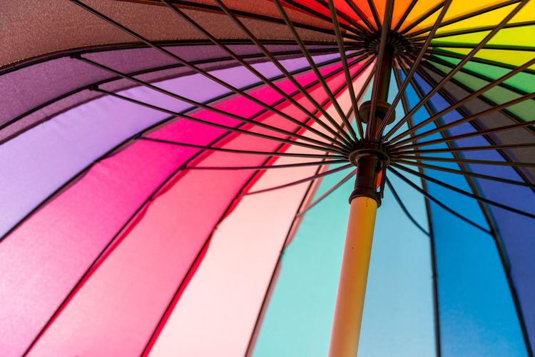 Low Angle View Of Multi Colored Umbrella