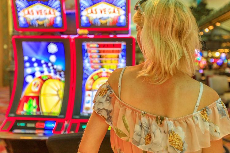 Rear view of woman standing in casino