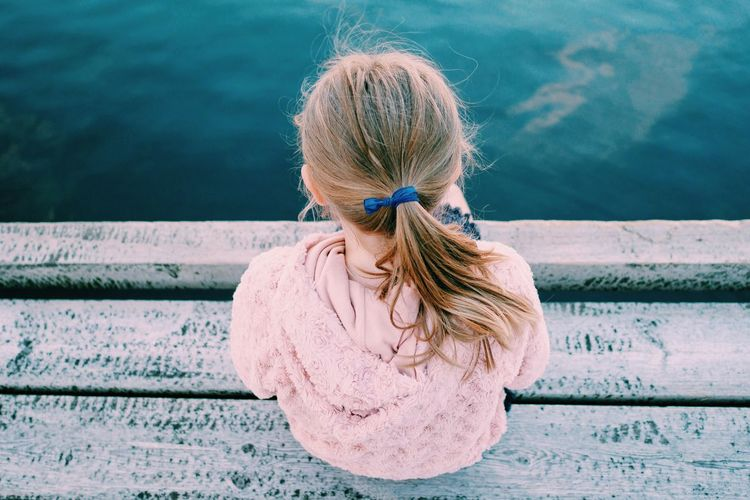 A Bird's Eye View Childhood Blond Hair Water Focus On Foreground Casual Clothing Medium-length Hair Day Person Person Summer Outdoors Innocence Sea