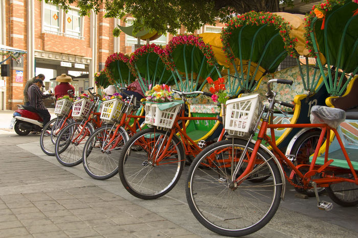 Adult Adults Only Architecture Beautiful Bicycle Bicycle Basket Building Exterior Business Chinese Taipei City City Life Cycling Day Full Length Land Vehicle Mode Of Transport Outdoors People Showers Stationary Taiwan Transportation Travel Tree Tricycle