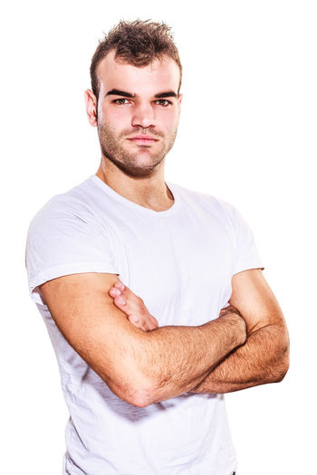 Unshaved confident good-looking macho man standing looking at the camera with folded arms and a serious expression in a casual t-shirt, isolated on white Athletic Man Masculinity Young Bristles Casual Clothing Cut Out Good-looking Guy Handsome Looking At Camera Men Menfashion Muscular One Person People Portrait Real People Standing Studio Shot T-shirt Unshaven Waist Up White Background Young Adult