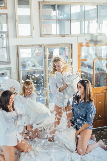 Bachelorette Party Feathers Friends Friendship FRIENDSHIPGOALS Fun Fun Times Girls GirlsNight Happy Laughter Mess Morning Morning Glory Morning Rituals Natural Light Party Pijama Pillow Pillowfight Sleepover Weekend Window Women Young Adult