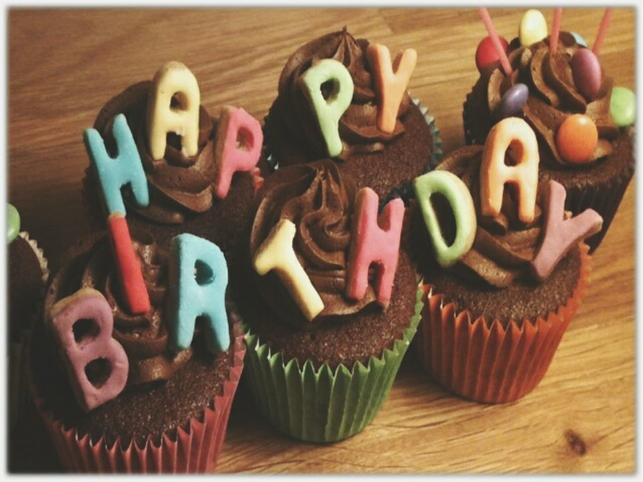 food and drink, indulgence, food, sweet food, indoors, freshness, temptation, still life, dessert, table, text, unhealthy eating, baked, no people, cupcake, ready-to-eat, birthday candles, cake, close-up, birthday cake, alphabet, day