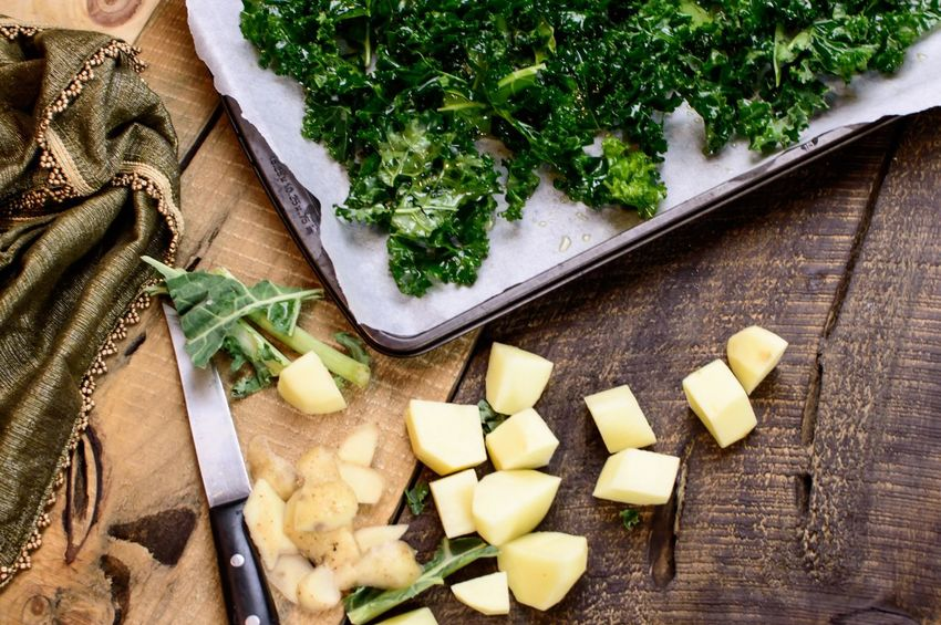 Fresh chopped kale and cut potatoes on vintage wood Piece Cut Chopped Vintage Rustic Healthy Food Healthy Eating Kale Kitchen Knife Cutting Board Food And Drink Studio Shot Preparation  Freshness Vegetable Bunch Healthy Eating Indoors  Raw Food Food High Angle View Wood - Material No People Chopping Chopped SLICE Close-up Food Stories Food Stories