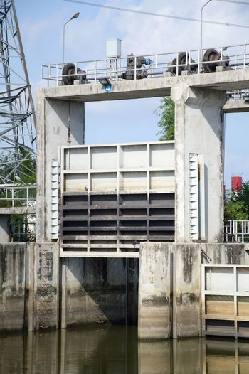 Chachoengsao Construction Water Gate Weathered Architecture Building Exterior Built Structure Canal Cement Countryside Dam Day Khlong Preng Nature No People Old Outdoors River Sky Tree Water