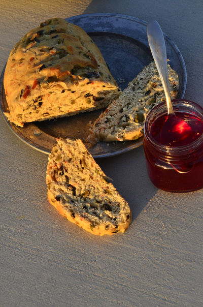 artisan made savoy olive loaf bread and artisan made sweet cactus fruit jelly Artisan Bread Artisinal Close-up Day Food Food And Drink Fresh Baked Bread Freshness Indoors  Jam Jars Jelly No People Preserves