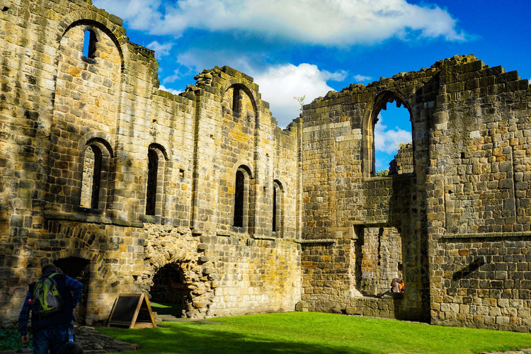 Kirkstall Abbey in Leeds, West Yorkshire, England Architecture History Built Structure The Past Building Exterior Ancient Sky Old Ruin Old Building Arch Nature Day Grass Travel Destinations Real People Damaged Travel Outdoors Tourism Ruined Ancient Civilization Deterioration Archaeology Stone Wall Leeds Abbey Ruins Church Sun England Travel Tourist Attraction