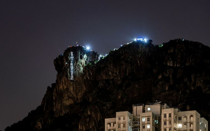 Hongkongers hike on and light up lion rock hill as human chains form with protest demands, 2019