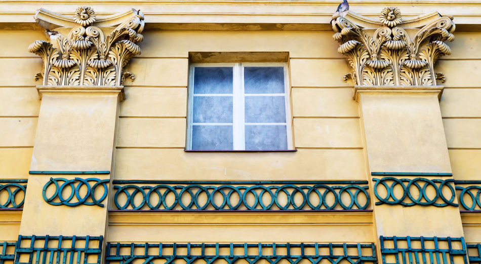 Ornate Wall Balcony Railing Residential District Representation Outdoors Wall - Building Feature Craft Creativity Low Angle View Day No People Art And Craft Window Building Building Exterior Built Structure Architecture Yellow Blue My Best Photo