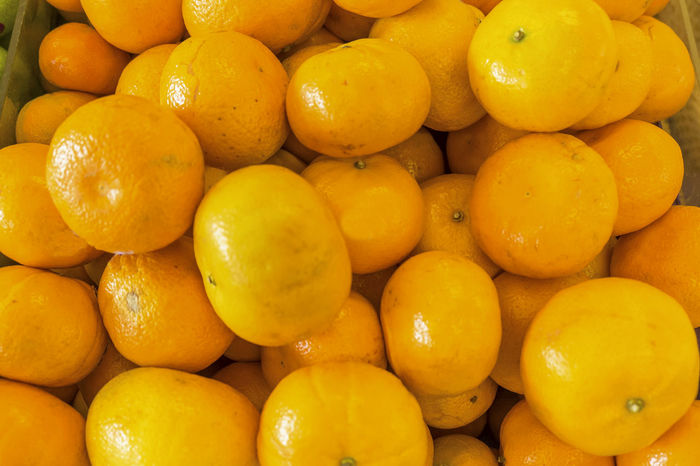 Bunch of fresh mandarin oranges on market Abundance Citrus Fruit Close-up Extreme Close Up Food Food And Drink Fresh Freshness Fruit Fruits ♡ Full Frame Healthy Eating Heap Large Group Of Objects Manderine Medium Group Of Objects No People Orange Repetition Retail  Vibrant Color Yellow