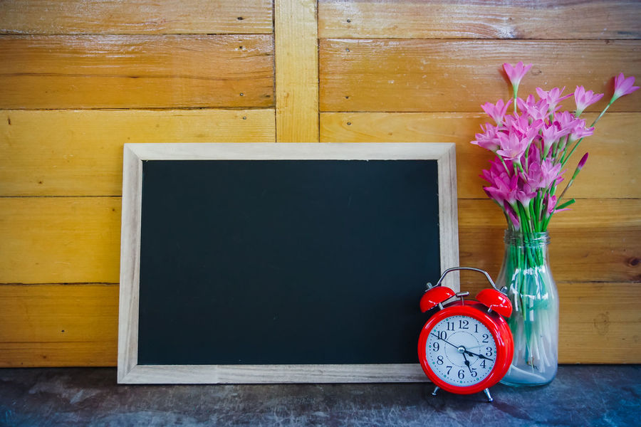 Wood - Material Table No People Indoors  Flower Flowering Plant Still Life Plant Vase Time Copy Space Red Alarm Clock Clock Container Decoration Blackboard  Picture Frame Frame Freshness