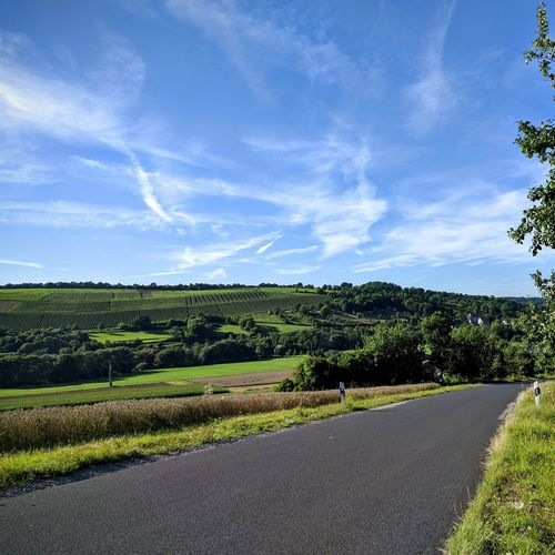 Landscape Road Tranquil Scene Blue Tranquility Sky Scenics Transportation Solitude The Way Forward Cloud Rural Scene Countryside Nature Long Field Green Beauty In Nature Day Plant
