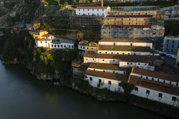 High angle view of townscape by river in city