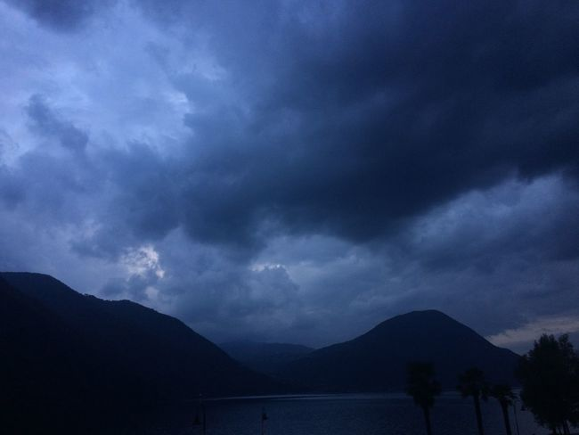 Darkness Palm Tree Beauty In Nature Cloud - Sky Darkness And Light Day Mountain Mountain Range Nature No People Outdoors Palmtrees Scenics Silhouette Sky Storm Cloud Water