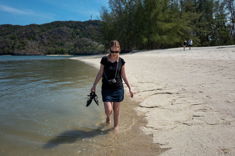 Langkawi One Person Water Real People Leisure Activity Nature Full Length Day Land Casual Clothing Beach Front View Lifestyles Walking Sunlight Standing Tree Plant Beauty In Nature Outdoors