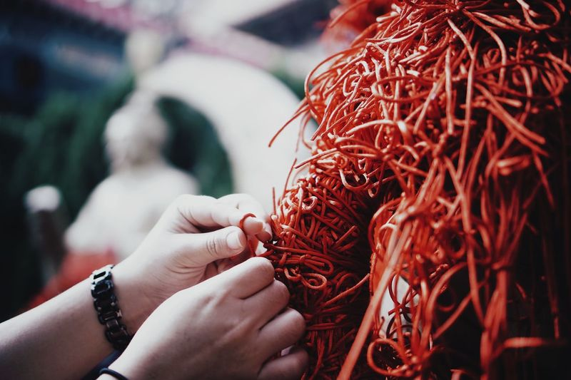 Cropped hand tying string