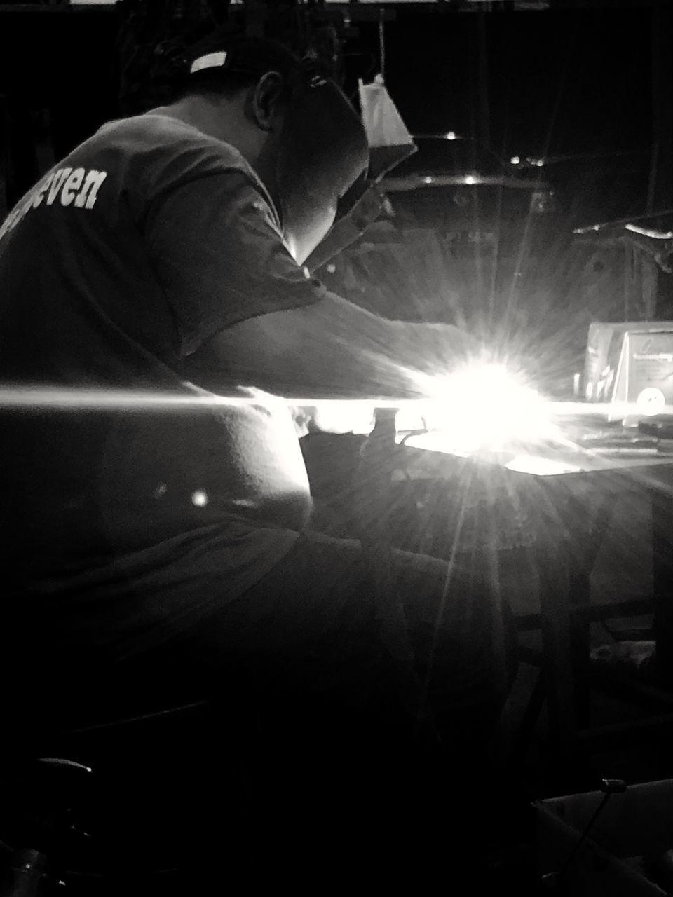 PEOPLE WORKING IN ILLUMINATED LIGHTS