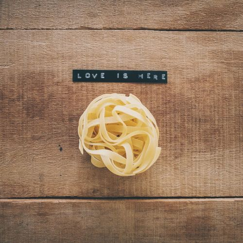 EyeEm Selects Italian Food Wood - Material Preparation  No People Text Indoors  Table Directly Above Yellow Studio Shot Close-up Freshness Day Love Pasta