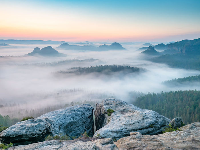 Popular kleiner winterberg view, beautiful misty valley in saxon switzerland, nature park in germany