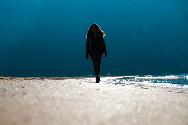 Rear view of woman standing on beach in turkey