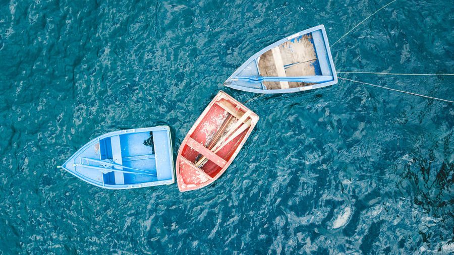 High angle view of sailboat floating on sea