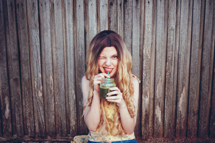 Portrait of beautiful woman having smoothie