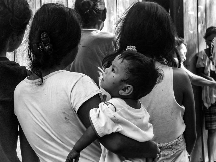 Tribal families. Baby Adult Day Togetherness People Lifestyles Real People Childhood Street Bnw_shot Bnw_collection Bnwphotography Bnw_society Bnw_life Bnw Photography Streetphotography Child Portrait Conflict Bnw_friday_challenge Close-up Black And White Friday Inner Power This Is Family