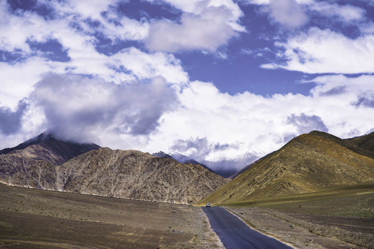 Just we and the beautiful terrains Hills India Ladakh Nature Calling Perspectives On Nature Wanderlust Beauty In Nature Car In The Hill Cloud - Sky Day Landscape Life On The Hills Mountain Mountain Range Nature No People Outdoors Physical Geography Road Scenics Sky Tranquil Scene Tranquility World World From Above