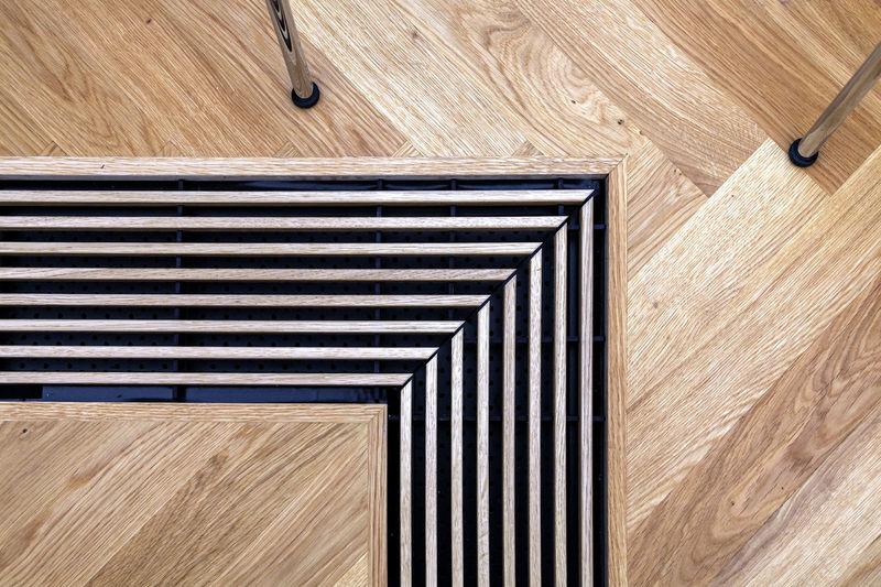 Directly above shot of hardwood floor over water