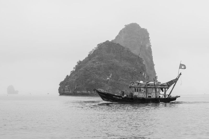 Nautical Vessel Transportation Mode Of Transportation Water Sea Scenics - Nature Waterfront Nature Sky Beauty In Nature Tranquil Scene Tranquility Day Mountain Travel Clear Sky Non-urban Scene Rock Formation Idyllic No People Outdoors Sailboat Ha Long Bay