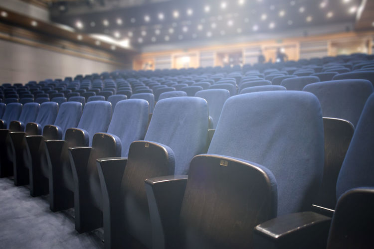 seats at the empty theater Theater Seats Empty Cinema Interior Inside Culture Arts Opéra Traditional Indoors  Entertainment Event Hall Public Amusement  Leisure Nobody Rows Lights Decoration Pattern Chair Row Seat Classical Comfortable Background Furniture Show Fancy Formal Stage Audience Film Auditorium MOVIE Performance Showtime Conference Many Detail Modern Side View Blurred Blue Illuminated Absence Repetition