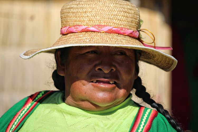 the matriarch of the family of a floating island. Titicaca Lake Portrait Human Face Headshot Looking At Camera Men Cowboy Hat Front View Hat Close-up