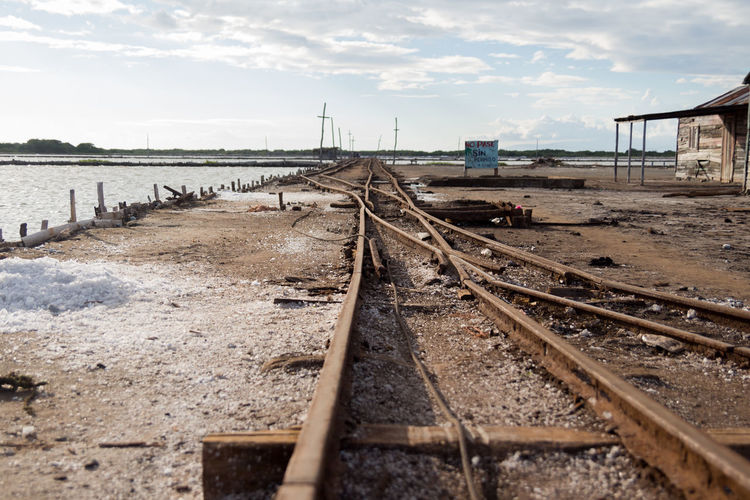 Bani Dominican Republic Railroad Track Vacations Backgrounds Built Structure Cloud - Sky Day Horizon No People Outdoors Playa Salinas Produccion Sal Rail Transportation Railroad Track Sky Skyscraper Transportation Water