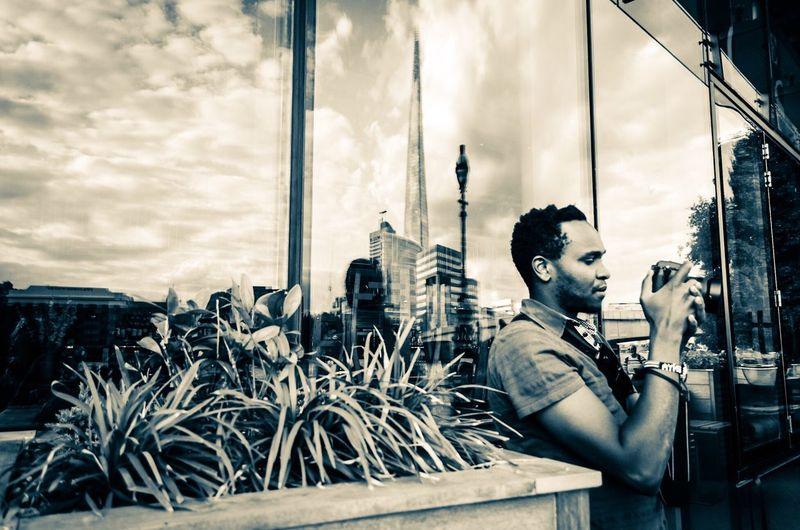 A tourist in London. Man Photographer London Shard Glass Reflections One Person Adult Hobbies And Interests Real People Cloud - Sky Outdoors Only Men One Man Only Monochrome Black And White Photography Mix Yourself A Good Time