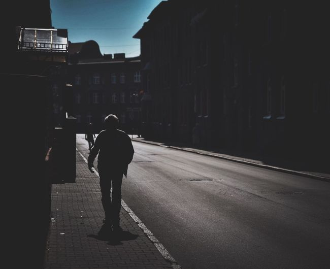 Full Length Street Walking Road Rear View Architecture One Person City Outdoors People Day Adult Silhouette Silhouettes EyeEm Selects EyeEm Best Edits EyeEm Gallery The Week On Eyem Summer Poland EyeEm Selects Your Ticket To Europe