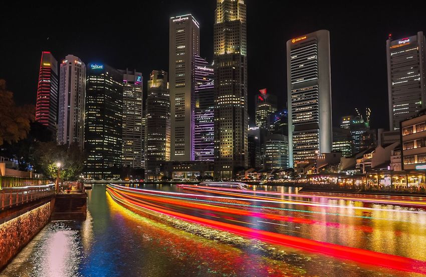 Night Illuminated Building Exterior Architecture Skyscraper Long Exposure Light Trail City Modern Speed Built Structure Motion Cityscape Downtown District No People Urban Skyline Outdoors Travel Destinations Multi Colored Urban Scene Singapore City Singapore Skyline Singapore river Singapore Night Life