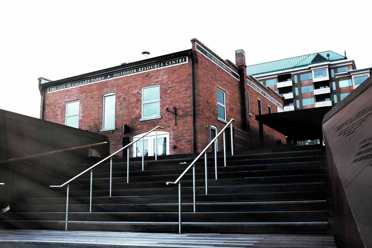 LOW ANGLE VIEW OF STAIRS AGAINST BUILDING