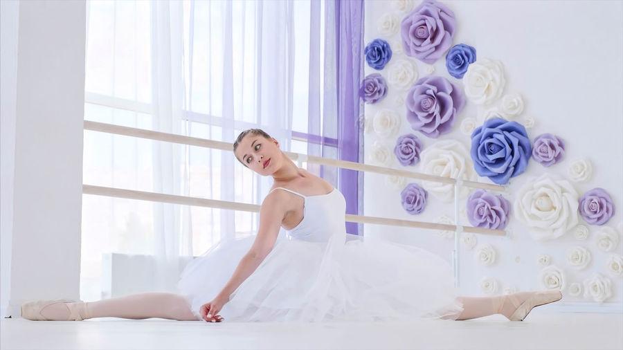 Beautiful woman practicing ballet in studio