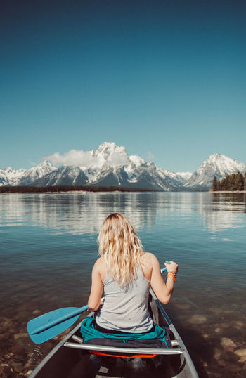 National Park Nature Nature Photography Mountain Mountain Range Canoe Outdoors Outdoor Photography Snow Grain Scenics - Nature Lake Water Rear View Sky Blond Hair Beauty In Nature Women Hairstyle